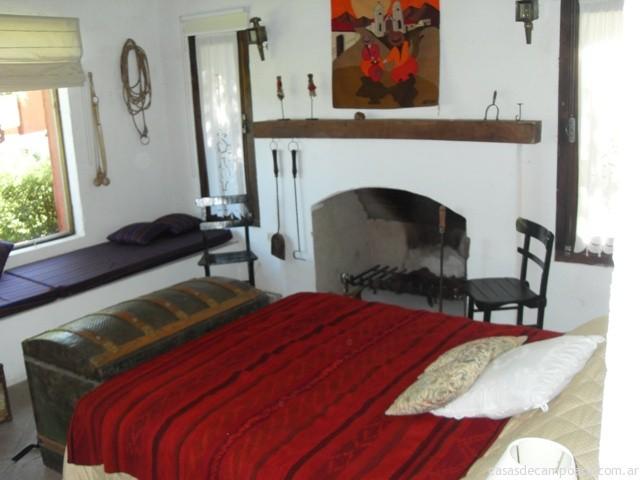 Dormitorio principal en suite apartado de la casa